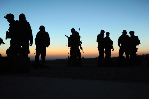 Afghan Commandos and U.S. Special Forces from Special Operations Task Force-East await movement for an operation, Nov. 28, 2010. (U.S. Army/Sgt. Justin Morelli)