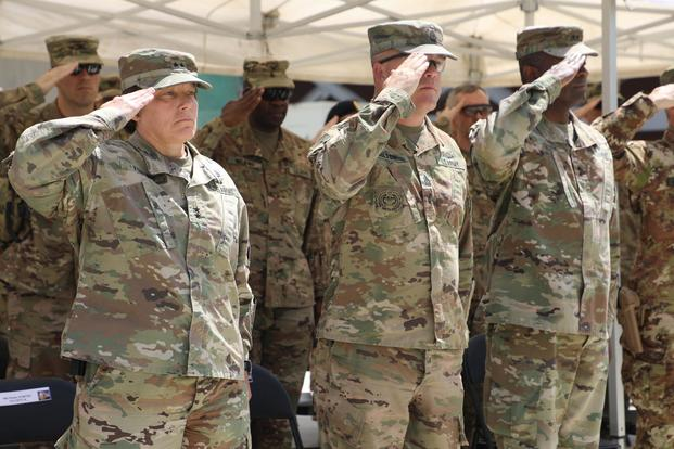 U.S. Army Maj. General Robin Fontes, commanding general of Combined Security Transition Command -Afghanistan salutes as the National Anthem plays during the ribbon cutting ceremony in Kabul, Afghanistan Sept. 8, 2018. (U.S. Army/Sgt. 1st Class Debra Richardson)