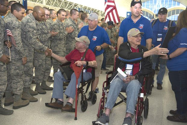 Veterans shake hands with airmen and other supporters on May 5 at their welcome home event in the San Antonio International Airport. Forty veterans took an Honor Flight to Washington D.C. to visit the World War II Memorial. (US Air Force photo/Shelby Pruitt)