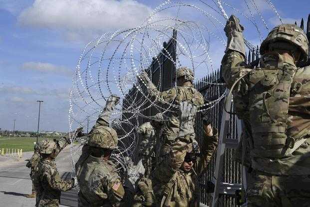 Soldiers from various Engineering Units install concertina wire Nov. 5, 2018, on the Anzalduas International Bridge, Texas. (US Air Force/Airman First Class Daniel A. Hernandez)