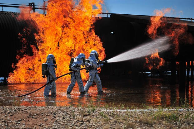 Firefighters work to extinguish a simulated engine fire at Cannon Air Force Base, N.M., Aug. 2, 2012. Chemicals associated with firefighting foam once used at the base have been detected in groundwater. (U.S. Air Force/Airman 1st Class Eboni Prince)