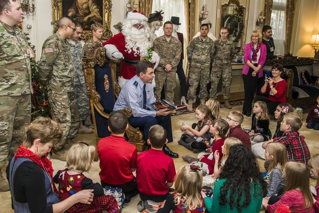 The Adjutant General of Colorado U.S. Air Force Maj. Gen. Mike Loh reads a holiday storybook, Dec. 13, 2017, at the Governor's Residence, to children of deployed Colorado National Guard members. ((U.S. Air National Guard/Maj. Darin Overstreet)