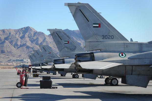 F-16 Desert Falcons from the United Arab Emirates air force are lined up on the flightline after returning from a mission during Red Flag 11-2 Jan. 31, 2011. (U.S. Air Force/ Staff Sgt. Benjamin Wilson)