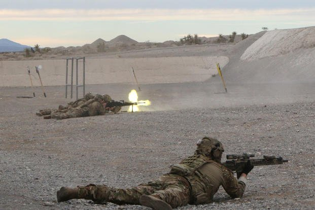 Sig Sauer's new lightweight machine gun is fired during a Sig Sauer range day in Last Vegas Jan. 20, 2019. The new MG has maximum effective range of about 2,000 meters and weighs about 20 pounds, about seven pounds lighter than the M240B machine gun. (Matthew Cox/Staff)