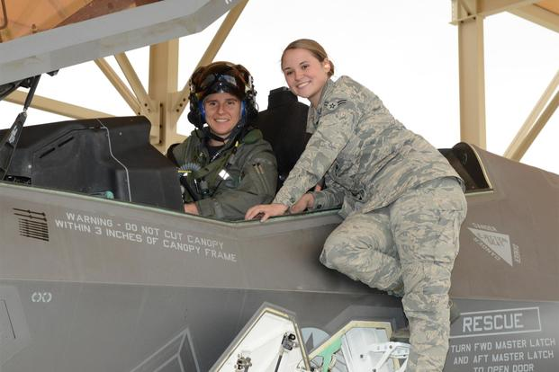 Maj. Rachael Winiecki, 461st Flight Test Squadron F-35 test pilot, and Airman 1st Class Heather Rice, 412th Aircraft Maintenance Squadron crew chief, pose for a photo after Winiecki's first test mission flight in the fifth-generation fighter Dec. 14, 2018. (U.S. Air Force/Kenji Thuloweit)