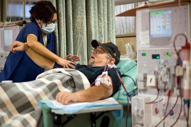 Senior Airman Gabrielle Oaxaca takes retired veteran Barry Silva's blood pressure during his dialysis treatment Oct. 13, 2010, at the David Grant USAF Medical Center at Travis Air Force Base, Calif. (U.S. Air Force/Tech. Sgt. Bennie J. Davis III)