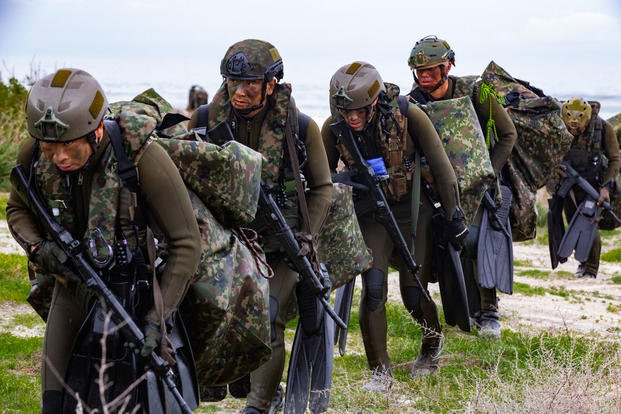 ea13410cef25cc ... Camp Pendleton in Amphibious Assault Training. Japan Ground  Self-Defense Force (JGSDF) Soldiers carry gear inland after performing a