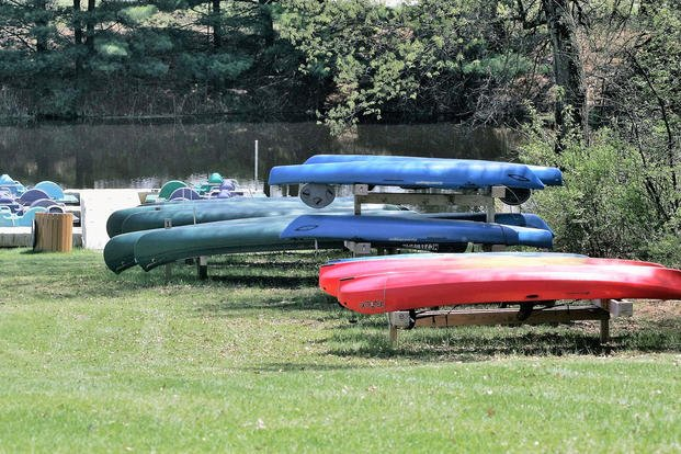 Recreational Equipment Checkout customers can check out paddle boats, canoes, and kayaks, like these located next to Suukjak Sep Lake on May 15, 2018, at Pine View Campground. (U.S. Army photo/Scott T. Sturkol)