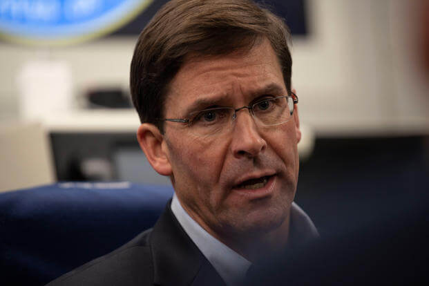 Acting U.S. Secretary of Defense Mark T. Esper speaks to reporters on a government aircraft en route to Brussels, Belgium, June 25, 2019. (DoD photo/Lisa Ferdinando)