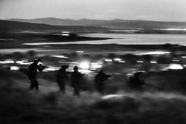 Greek special forces and U.S. Navy SEALs attack an objective under the cover of night during Sarisa 16, an annual Greek exercise, near Thessaloniki, Greece, on Sept. 20, 2016. (U.S. Army photo by Staff Sgt. Marcus Fichtl)