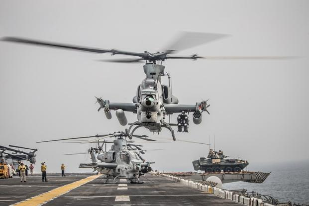 An AH-1Z Viper attached to Marine Medium Tiltrotor Squadron (VMM) 163 (Reinforced), 11th Marine Expeditionary Unit (MEU) takes off during a strait transit aboard the amphibious assault ship USS Boxer (LHD 4). (U.S. Marine Corps/Lance Cpl. Dalton S. Swanbeck)