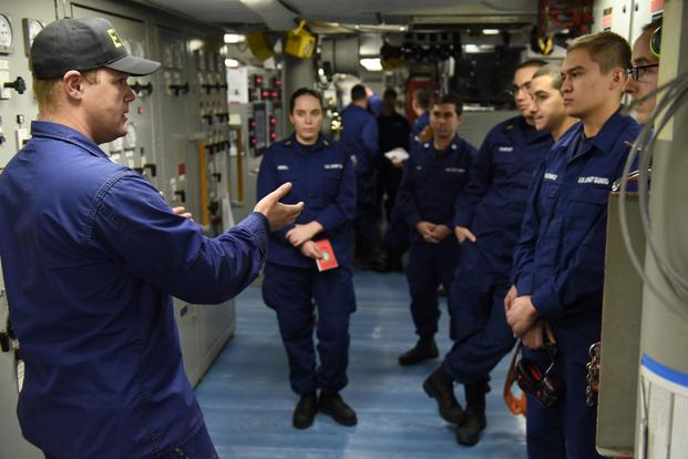 Petty Officer 2nd Class Keith Bryan, a machinery technician in the Coast Guard Cutter Polar Star's main propulsion division, explains simulation procedures before engineering casualty exercises while underway in the Ross Sea, near Antarctica, Feb. 4, 2016. (U.S. Coast Guard/Petty Officer 2nd Class Grant DeVuyst)