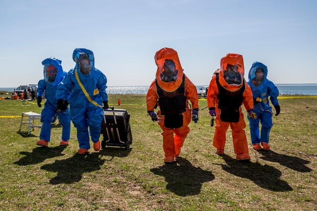 New York National Guard Soldiers and Airmen of the 24th Weapons of Mass Destruction Civil Support Team (CST) and 106th Rescue Wing prepare to identify and classify several hazardous chemical and biological materials during a collective training event at the Plum Island Animal Disease Research Facility, New York, May 2, 2018. (U.S. Army National Guard photo/Harley Jelis)