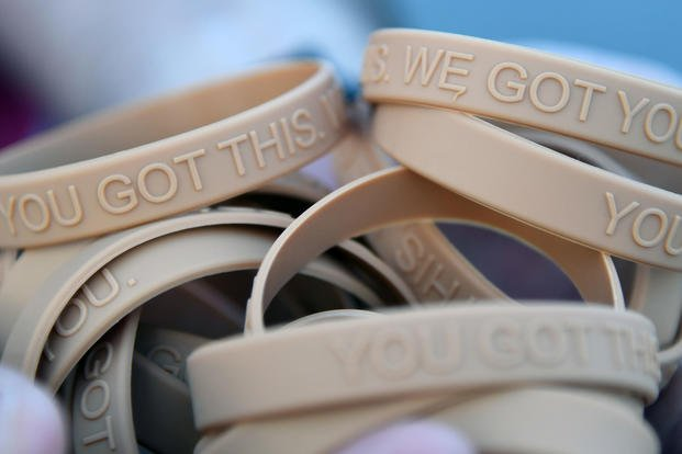"Bracelets, labeled with the message, ""You Got This. We Got You,"" are handed out to participants during the Dragon March on Keesler Air Force Base, Mississippi, Sept. 13, 2019. (U.S. Air Force/Kemberly Groue)"