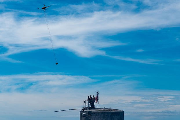 An unmanned aerial vehicle delivers a five-pound payload to the Virginia-class fast-attack submarine USS Hawaii (SSN 776) during a training exercise off the coast of Oahu, Oct. 10, 2019. (U.S. Navy photo/Michael B. Zingaro)