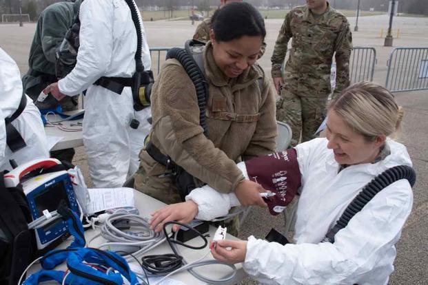 Pennsylvania Guard Members test medical equipment at a a coronavirus testing site in Upper Dublin Township.