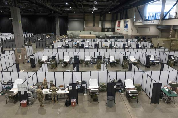 Soldiers work to set up a field hospital in the Centurylink Field Events Center in Seattle.