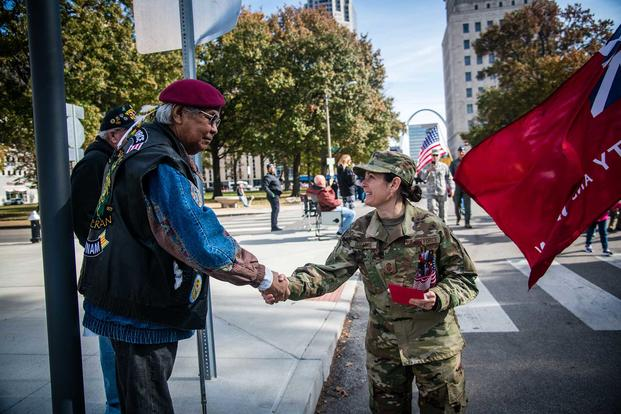 A service member thanks a veteran during the St. Louis Veterans Day Parade.