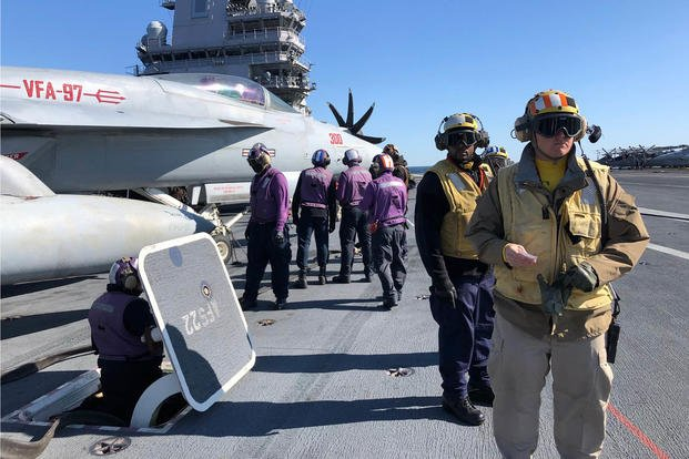 Crew of the carrier Gerald R. Ford prepare to fuel aircraft on the flight deck Nov. 17. 2020 (Hope Hodge Seck/Staff)