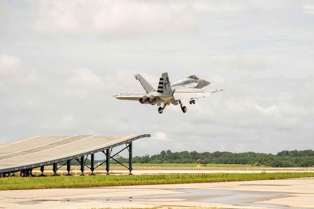 Boeing Super Hornet demonstrates ski-jump launch capability.