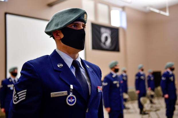 An airman stands in formation during a SERE Specialist Apprentice Course graduation ceremony.