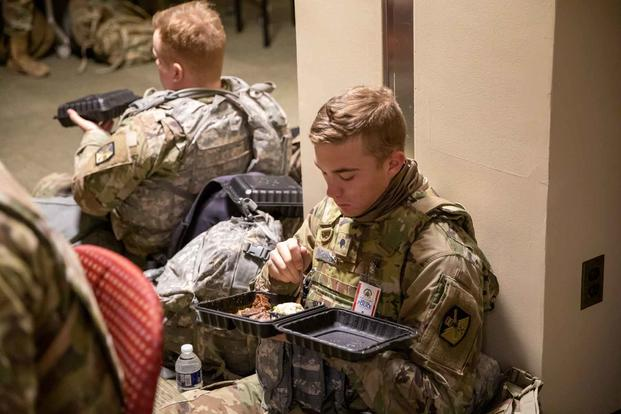 U.S. soldiers with the Utah National Guard eat a meal while on a break in Washington, D.C., Jan. 16, 2021. (U.S. Army National Guard/Sgt. Jordan Hack)