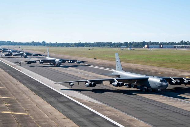 B-52H Stratofortresses line up on the runway.