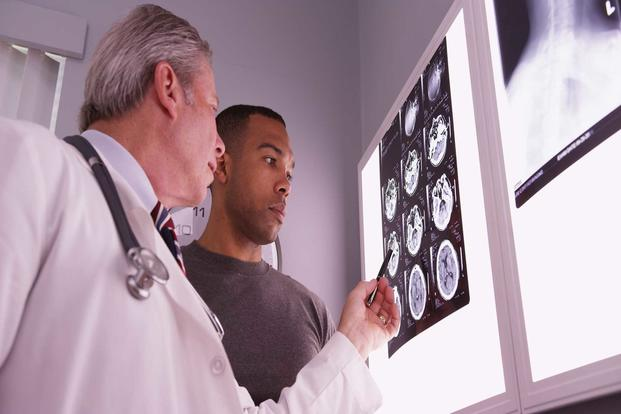 Doctor and patient examining brain scans