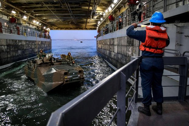 Japanese amphibious assault vehicle in the well deck of the amphibious transport dock ship USS Somerset