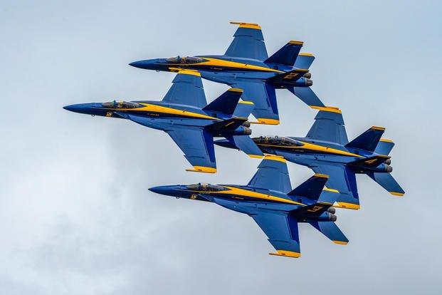 Blue Angels perform the Diamond 360 maneuver over Orlando Melbourne International Airport