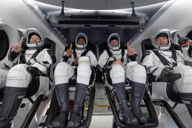 NASA astronauts seen inside the SpaceX Crew Dragon Resilience spacecraft onboard the SpaceX GO Navigator recovery ship.