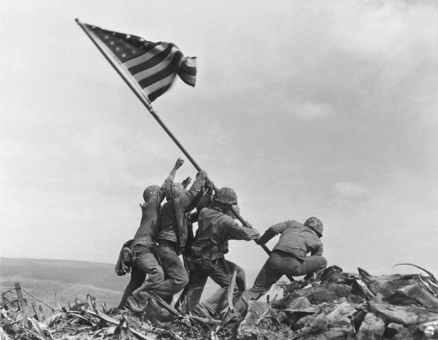 U.S. Marines raise an American flag atop Mt. Suribachi, Iwo Jima