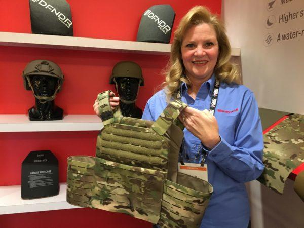 Lori Wagner of Honeywell displays an armored plate carrier made with the new Centurion fabric. Photo by Hope Hodge Seck