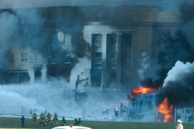 Local police, firefighters and first responders battle to put out the fires at the Pentagon after a hijacked jetliner, American Airlines Flight 77, crashed into the south face of the building, Sept. 11, 2001. (Marine Corps photo/Cpl. Jason Ingersoll)