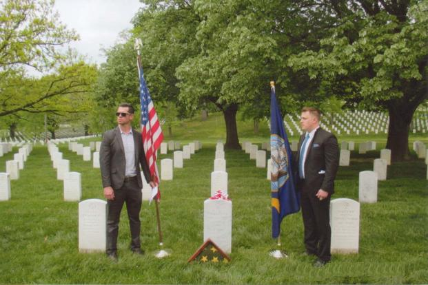 Relatives of the late Charles R. Trescott stand at Arlington National Cemetery, Va., near his new gravestone that lists the Silver Star awarded for his heroic actions on May 3, 1966, in Quang Tin Province in South Vietnam. (Photo courtesy Bill Ivory)
