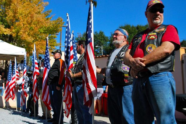 A group of motorcycle riders stand proudly during a ceremony honoring veterans at the Panama City Rescue Mission Nov. 11. The event provided free meals to homeless veterans. (Air Force Photo)