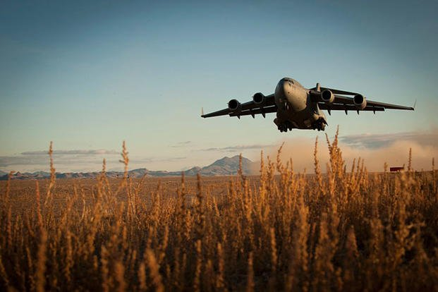 A C-17 Globemaster III takes off from a degraded airfield Dec. 6, 2014, during the Air Force Weapons School's Joint Forcible Entry Exercise 14B at the Nevada Test and Training Range. Joshua Kleinholz/U.S. Air Force