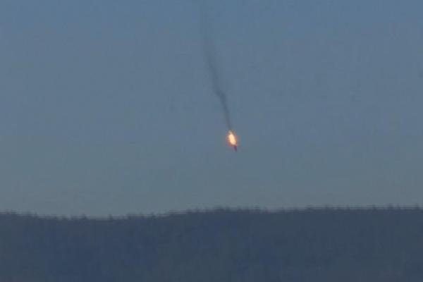 This frame grab from video by Haberturk TV, shows a Russian warplane on fire before crashing on a hill as seen from Hatay province, Turkey, Nov. 24, 2015. Turkey shot down the Russian warplane, claiming it had violated Turkish airspace. (Haberturk TV)