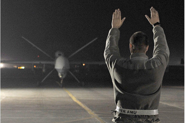 An MQ-9 Reaper returns from a mission on Dec. 1, 2010, at Kandahar Airfield in Afghanistan. (Air Force/Chad Chisholm)