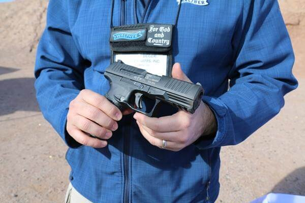 Everett Deger, marketing director with Walther Arms, highlights the company's first-ever .45-caliber pistol, the PPQ 45, at SHOT Show in Las Vegas, Jan. 18, 2016. (Photo by Brendan McGarry/Military.com.)