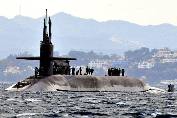 USS Florida (SSGN 728), an Ohio-class ballistic missile submarine, arrives off the island of Crete in 2010. The new Columbia class of subs would replace the Ohio class. (US Navy photo)