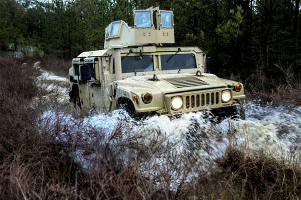 U.S. Marines drive a Humvee through the Combat Vehicle Operators Training Course at Camp Lejeune, N.C., on Dec. 6, 2016. (US Marine Corps photo/Tyler Stewart)