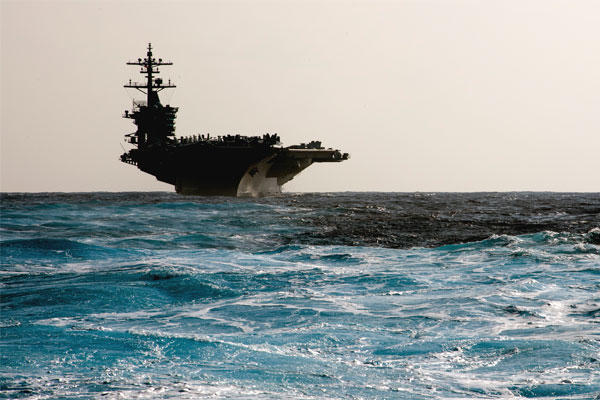 "The Navy aircraft carrier USS Carl Vinson transits the Pacific Ocean on Jan. 18. As it approaches the Korean peninsula, North Korea has threatened to sink it as a demonstration of its ""military prowess."" (US Navy photo/Nathan Serpico)"