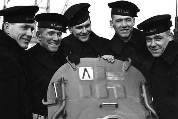 The Sullivan brothers on board the USS Juneau; from left to right: Joseph, Francis, Albert, Madison and George, February 14, 1942. U.S. Naval Historical Center photo.