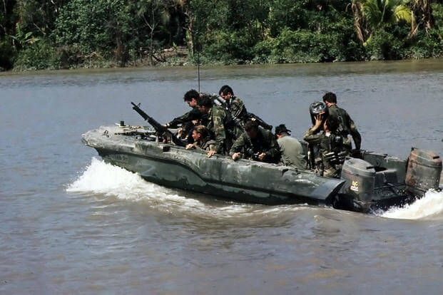 Republic of Vietnam...Members of U.S. Navy Seal Team One move down the Bassac River in a Seal team Assault Boat (STAB) during operations along the river south of Saigon., 11/1967 (Photo: National Archives)
