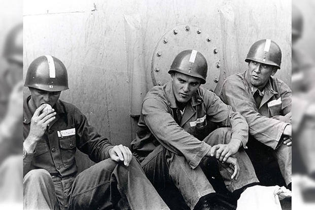 Lt. j.g. J. Robert Kerrey (center). (Photo: National Archives)