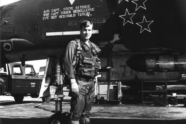 On the flightline at Udorn Air Base, Thailand, Ritchie stands next to his F-4 Phantom displaying five stars to reflect each of the MiG-21s he shot down during the Vietnam War. (Photo: U.S. Air Force)