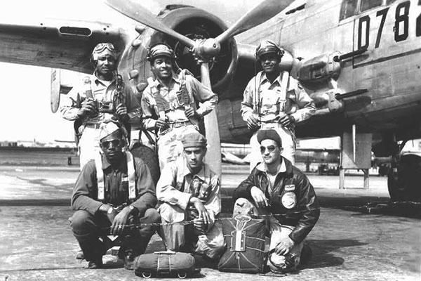A Tuskegee Airman crew poses in front of a B-25. (Courtesy photo)