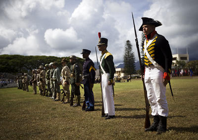 Marines wearing historical uniforms, field lineup.
