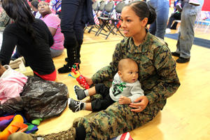 A Marine sitting with her baby son.